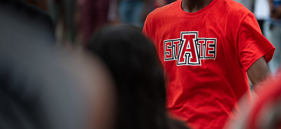 A student in an A-State t-shirt