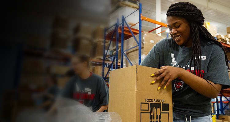 A student working at the food bank