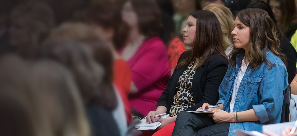 Women listening to the speaker at the Women's Business Leadership Conference