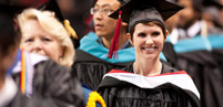 Graduate smiling at commencement