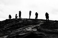 Black and white photos of the students taking photos on a rock formation