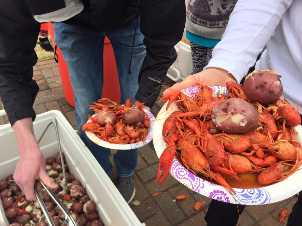 Students fill up their plate at the Crawfish Boil as a part of SAB's Mardi Gras Celebration.