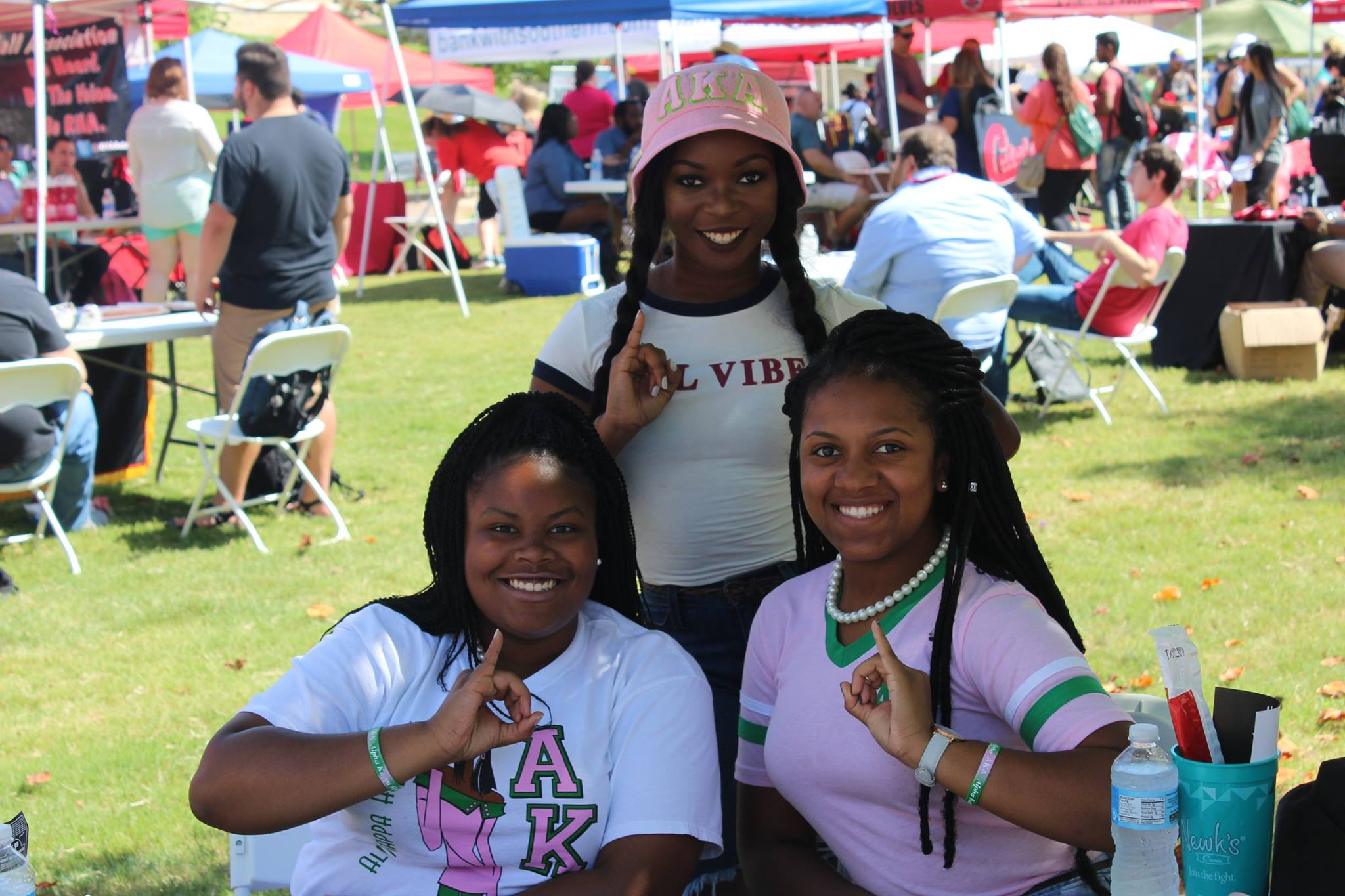 A picture of 3 women in Alpha Kappa Alpha Sorority