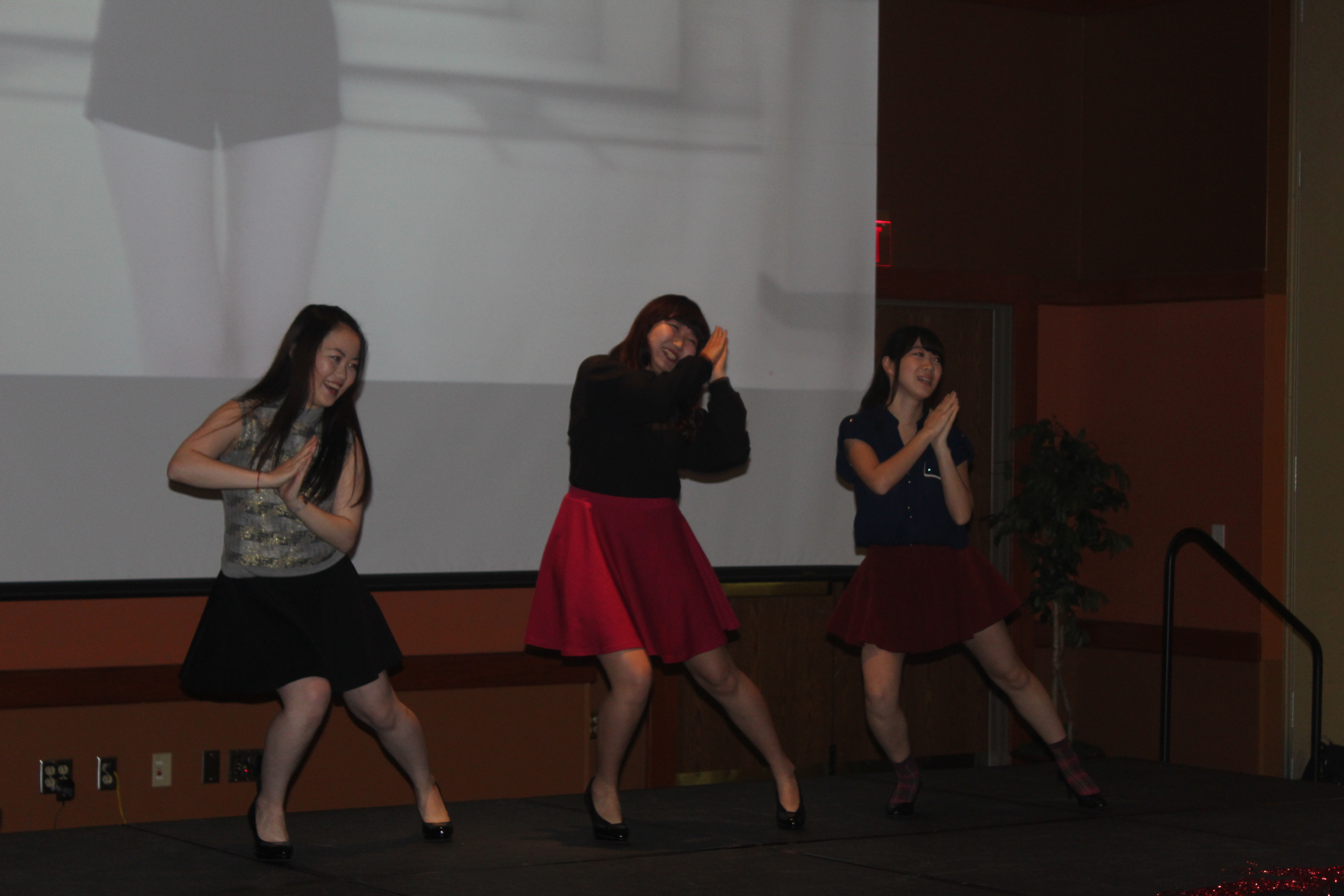 3 Chinese women dancing