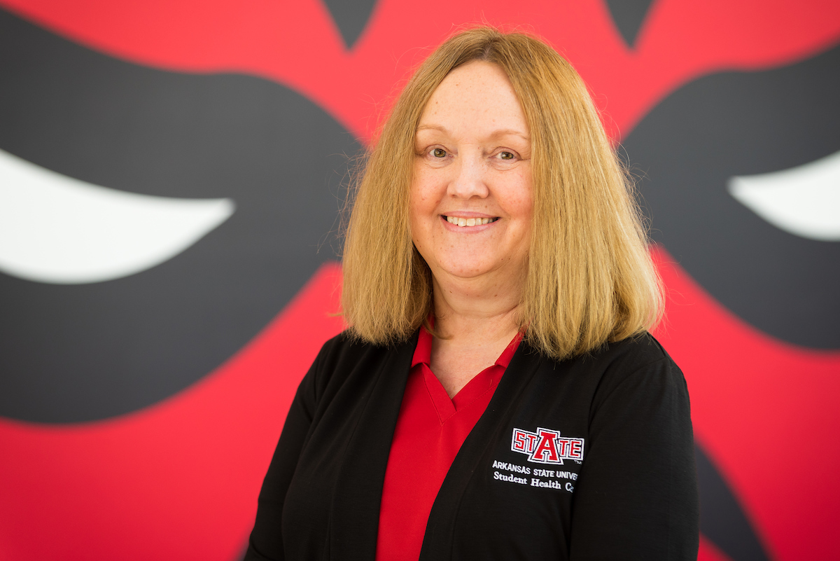 Karen with Red Wolf Logo