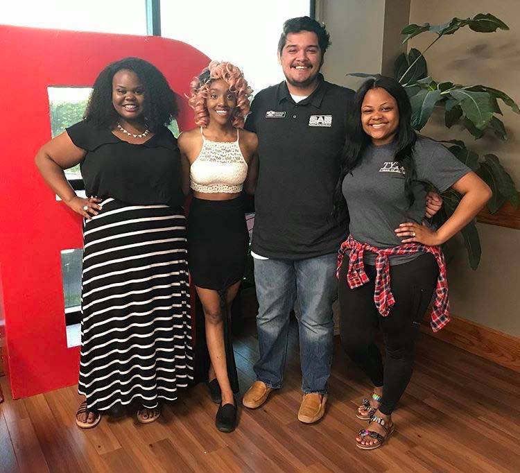 Spoken Word Artist Ashlee Haze poses with A-State students.