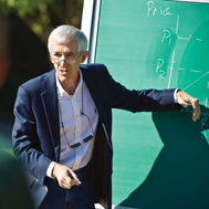 Professor at a chalkboard