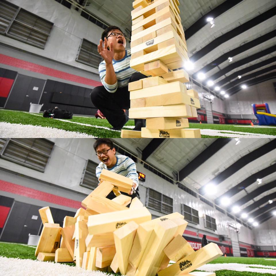 A student plays Giant Jenga at SAB's Jumbo Game Night.