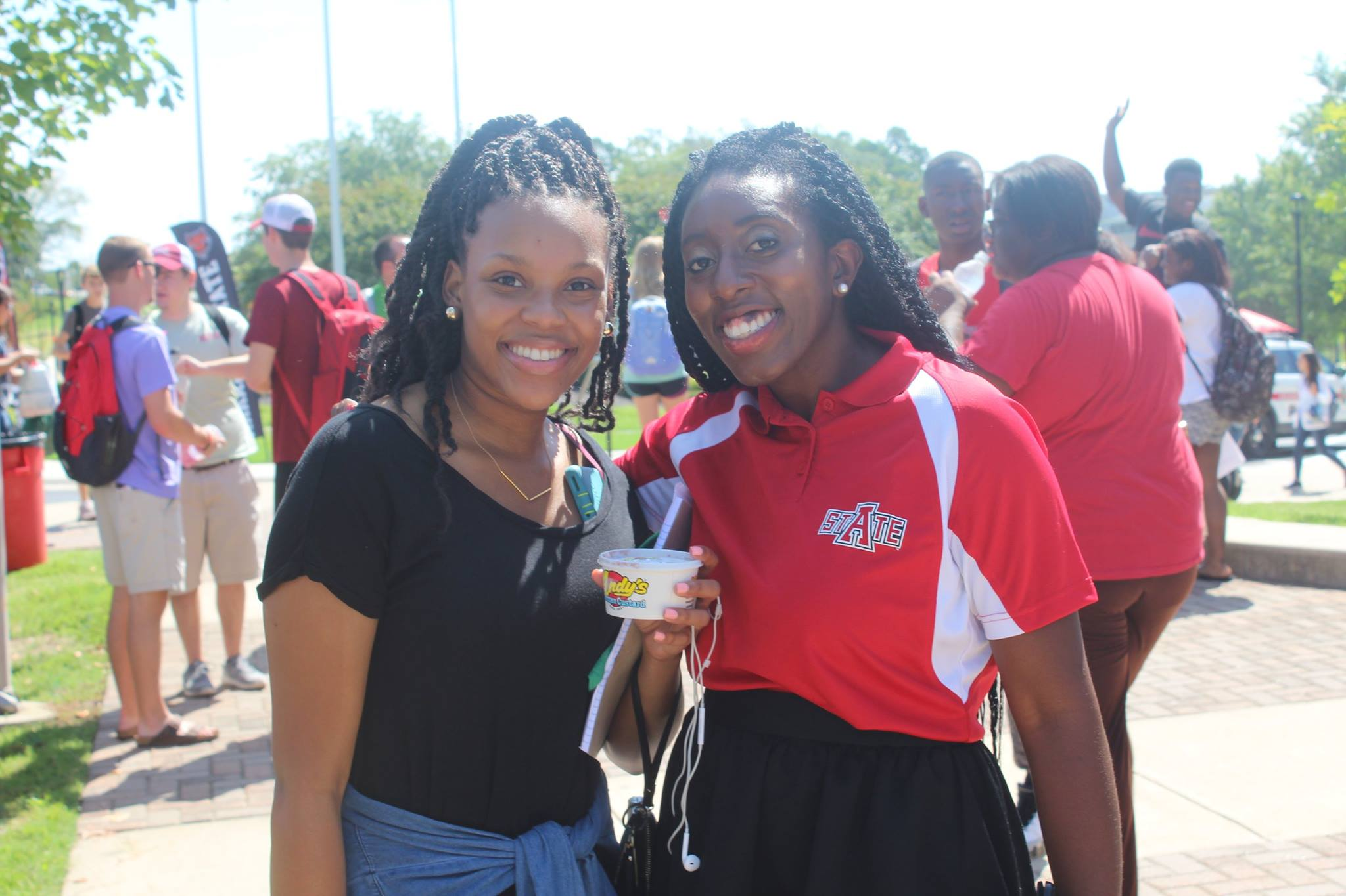 A female black faculty member with a female black student