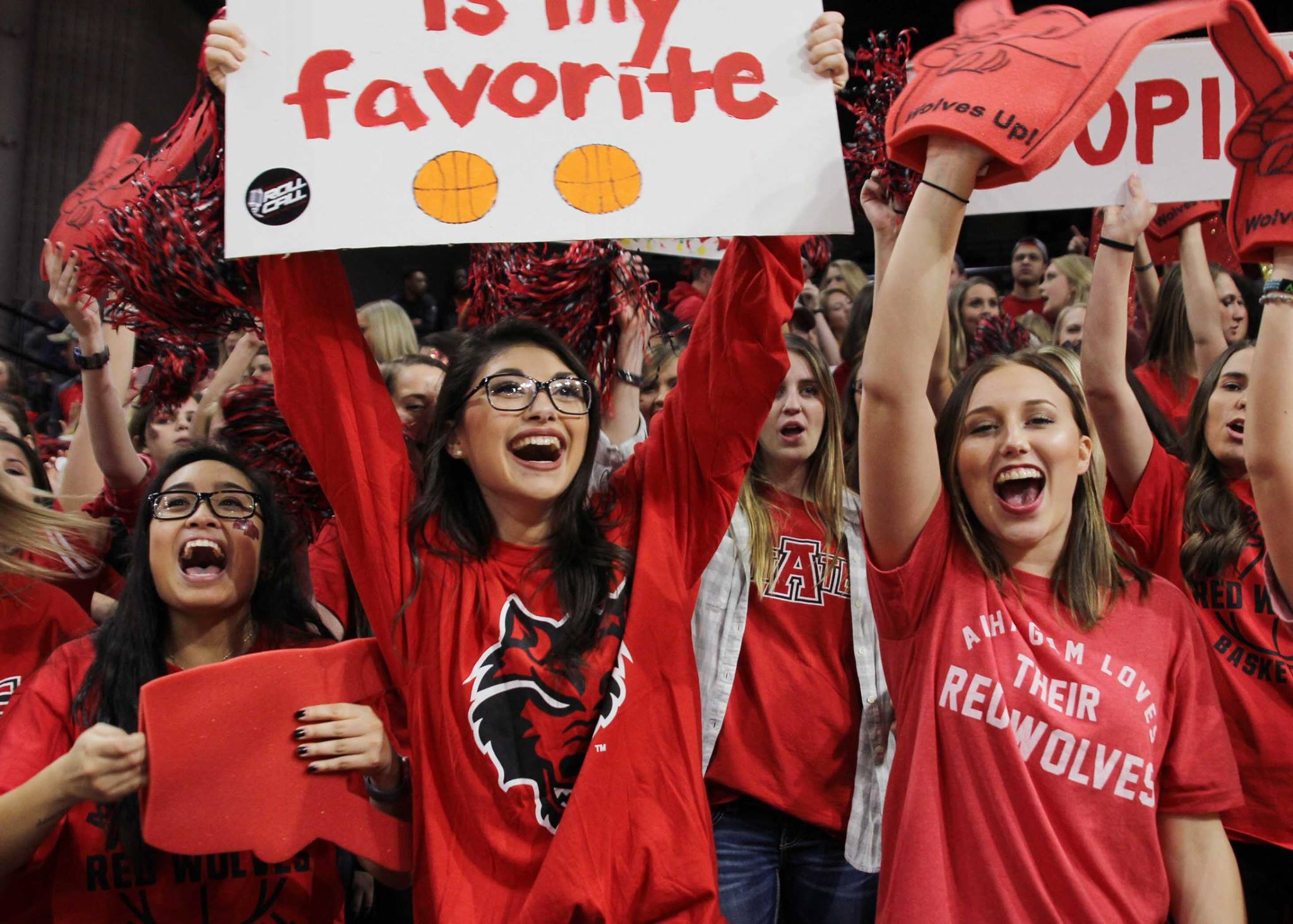 Students cheer on the A-State Men's Basketball Team at Pack Pride Day.