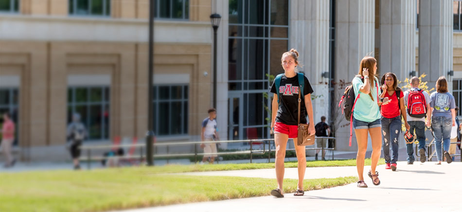 Students walking in front of the Humanities and Social Sciences Building