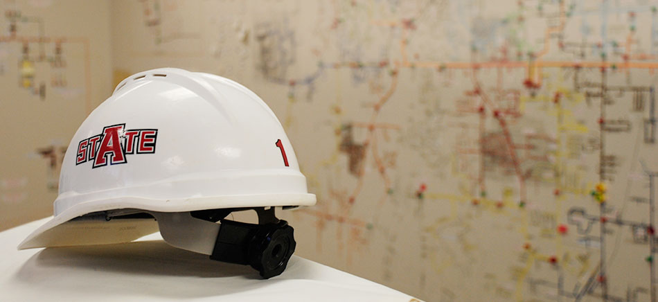 A white construction hard hat with the A-State logo.