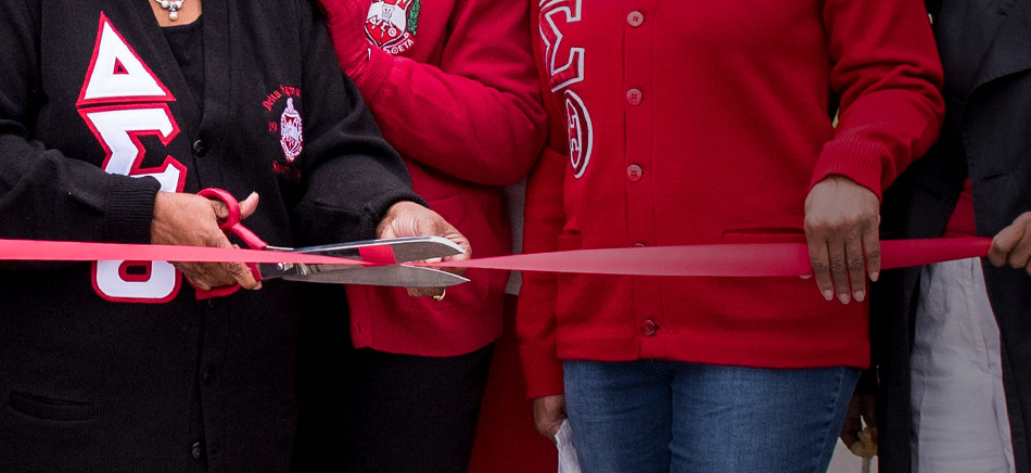 A close up photo of the ribbon being cut at the ceremony