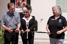 Tommy and Joanne Cash cutting the ribbon at the grand opening