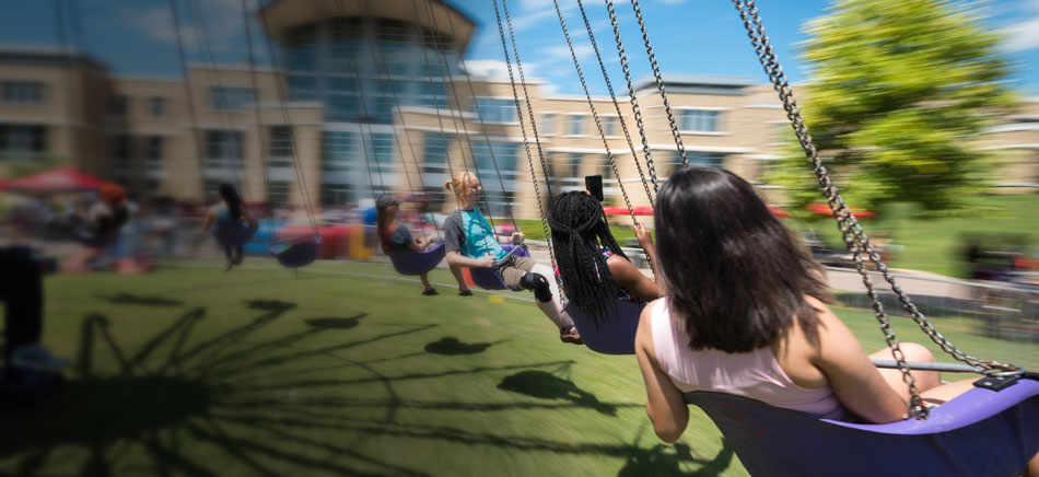 Students riding a swing during