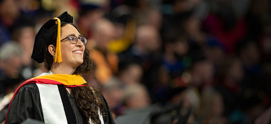 A graduate at the 2019 Spring Commencement