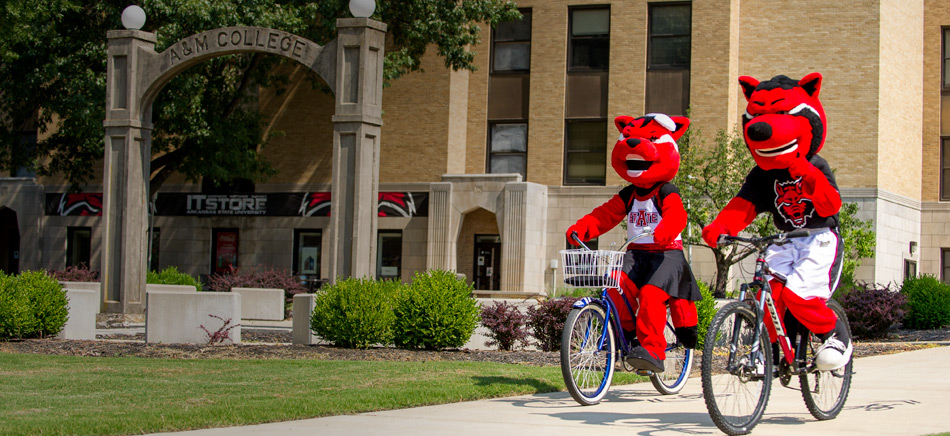 Howl and Scarlett riding bikes on campus