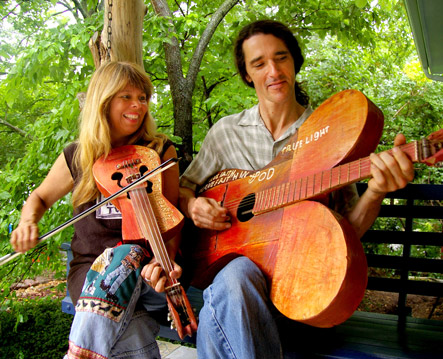 Kelly-and-Donna-on-bench-with-Stilly-instruments-web