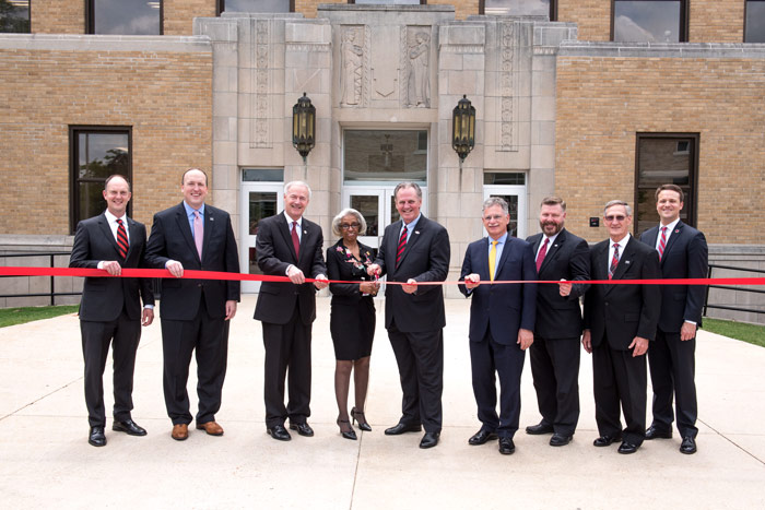 Officials cut the ribbon at the Wilson Hall Rededication Ceremony