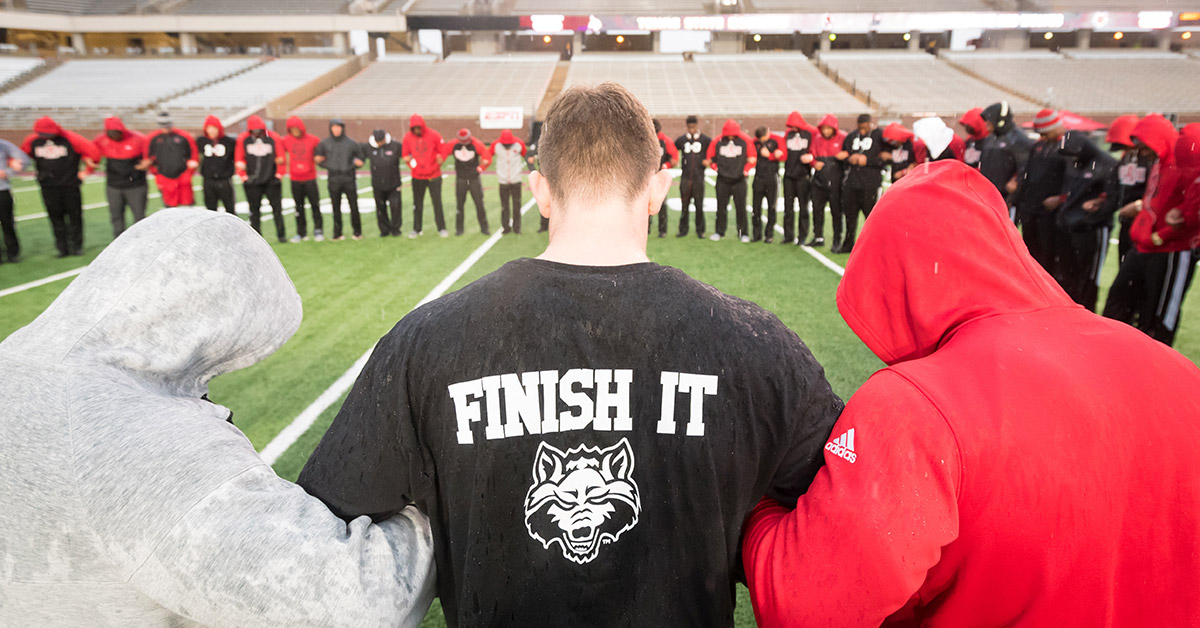 The Red Wolves huddle before the game