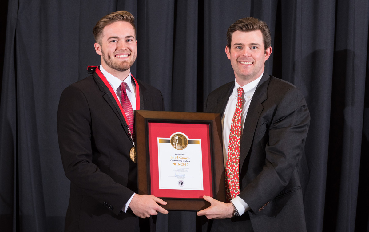 Jared Gowen accepts the 131st Wilson Award from Perry Wilson