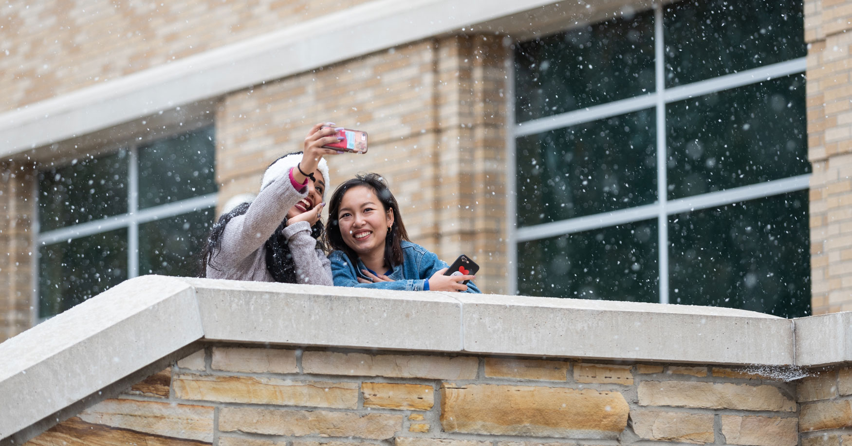 Students taking a selfie in the snow