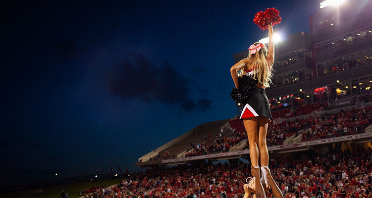 A cheerleader at an A-State football game