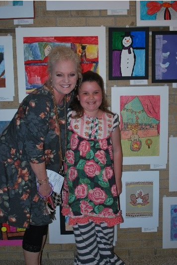 Child with her art teacher