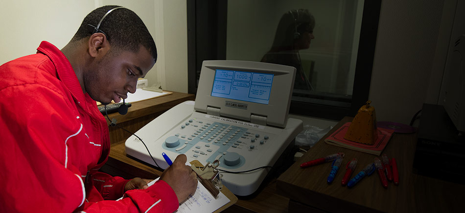 A student in a communications lab