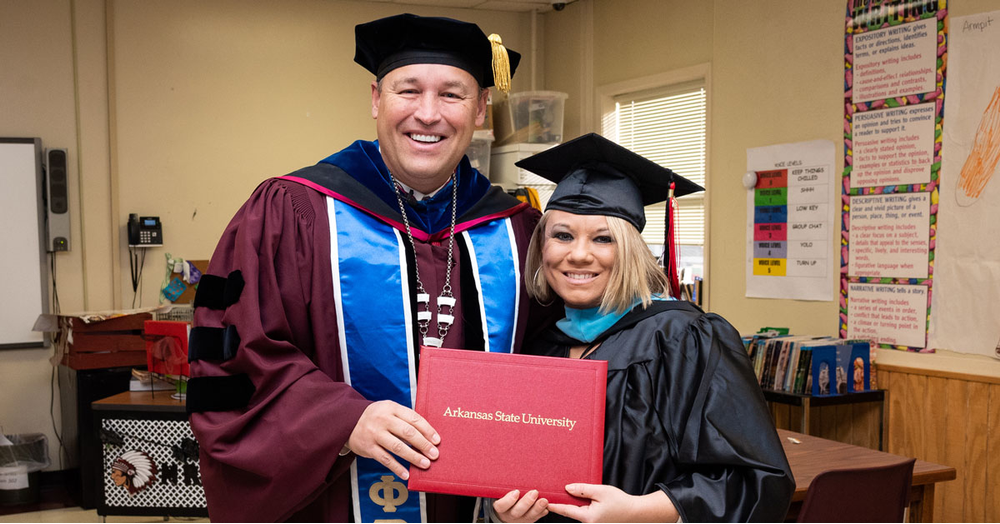 Chancellor Brings Commencement to Graduating Student