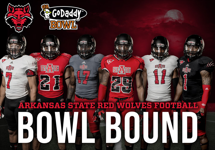 A-State Players and the GoDaddy Bowl Logo
