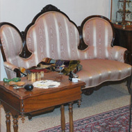 antique sofa and table in the Mary Stack Gallery