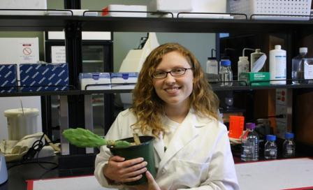 Anastasia Woodard with a cactus in the lab