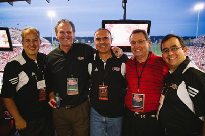 Oscar Franco, Chancellor Tim Hudson, Gov. Jose Calzada, Jonesboro Mayor Harold Perrin, Edmundo Ortiz enjoying a Red Wolves football game