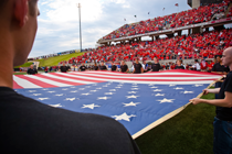 American flag at football game