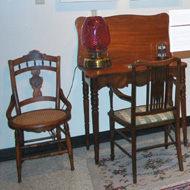 antique chairs and table in the Mary Stack Gallery