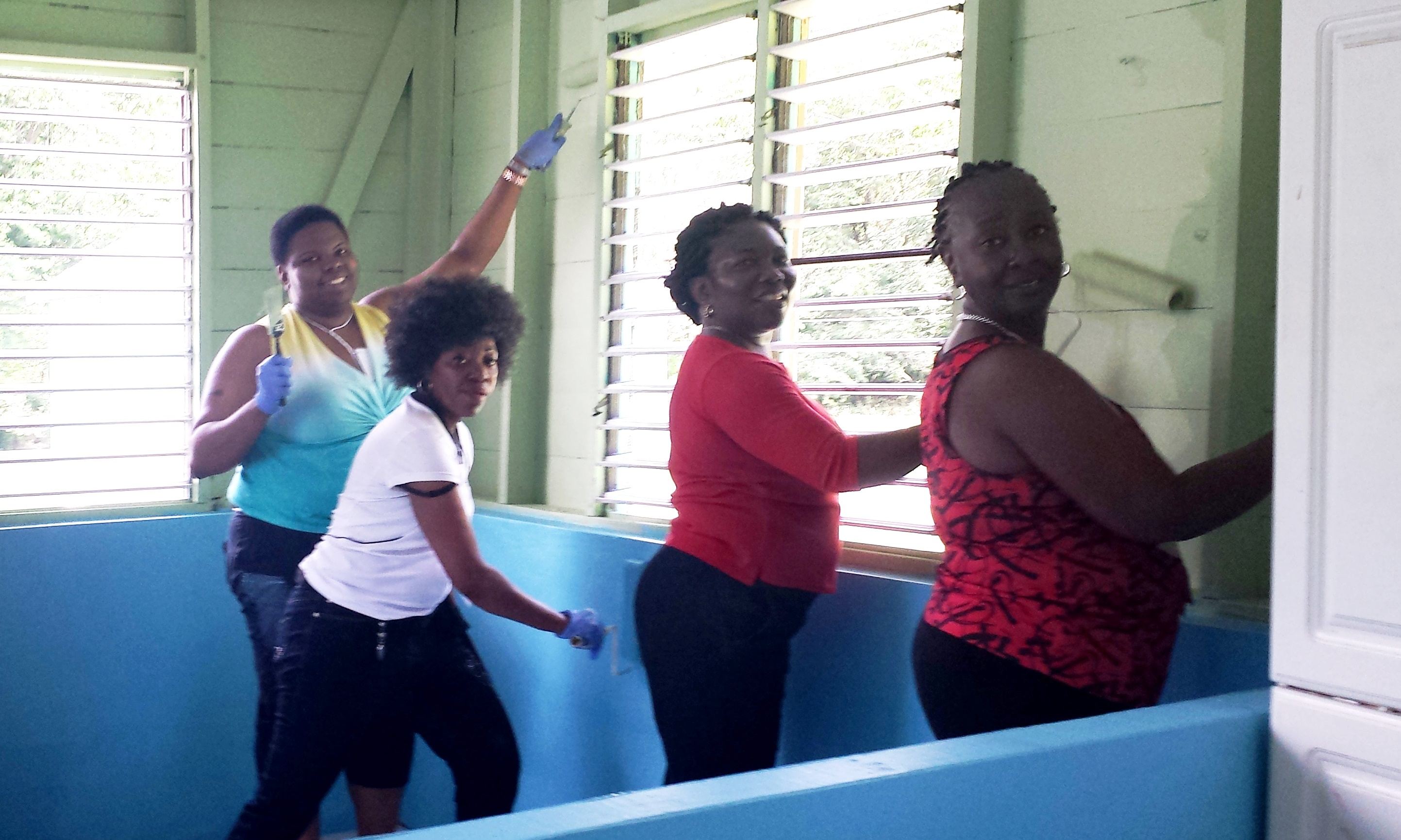 Social Work faculty and student doing community service in Jamaica