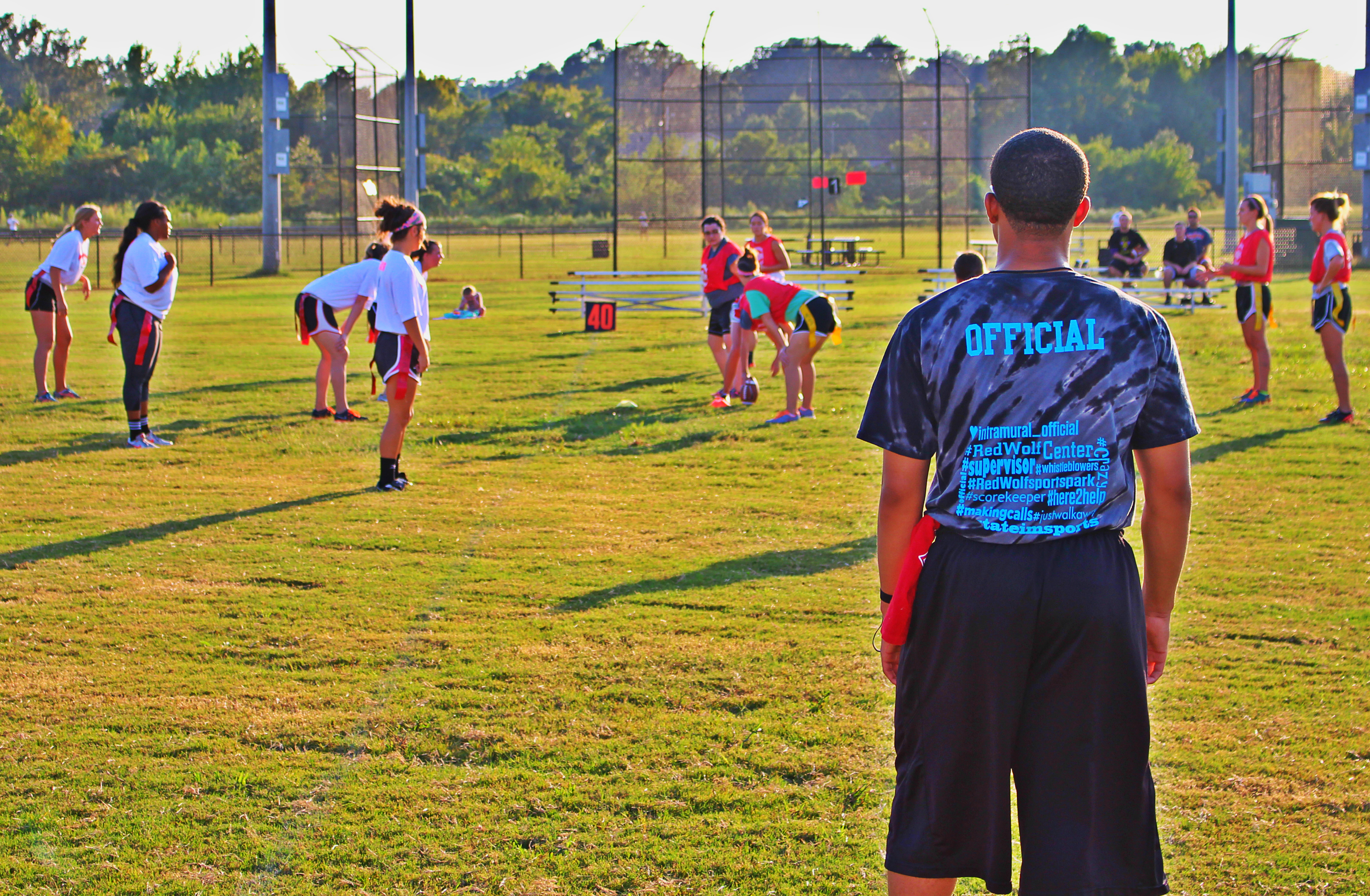 Picture of referee and players during flag football