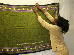 Woman pinning a blanket