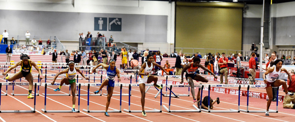 Sharika Nelvis takes the lead during the Indoor Track and Field Championships
