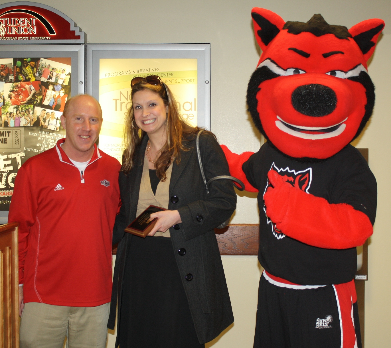 Darla Fletcher, with Coach Brian Boyer and Howl