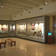 distant interior view of the Native American Gallery display cases